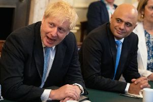Sajid Javid, seen in Cabinet with Boris Johnson, resigned as Chancellor rather than accept a joint team of advisers imposed by Downing Street (Picture: Aaron Chown/PA Wire