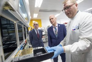 Scotland's Public Health Minister Joe FitzPatrick (centre) and Professor Rory Gunson (left) look on as clinical support technician Douglas Condie (right) extracts viruses from swab samples so that the genetic structure of a virus can be analysed and identified in the coronavirus testing laboratory at Glasgow Royal Infirmary.