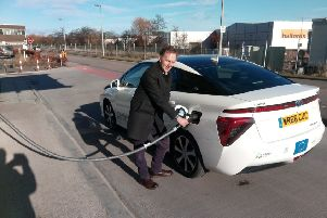 Alastair Dalton refuelling a Co-wheels Car Club Toyota Mirai car in Aberdeen. Picture: The Scotsman