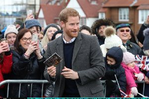 Huge crowds turned out to greet Prince Harry when he visited Edinburgh Castle with Meghan Markle in February 2018.