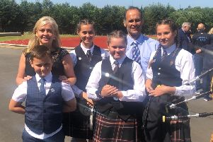 Lynda McIntyre, of the Save North Lanarkshire Instrumental Services campaign group, with husband Frank and children: Hannah, Amy, Rebecca and Robbie, who are all members of the North Lanarkshire Schools Pipe Band.