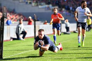 Scotland captain Stuart Hogg soars over for a brilliant try - the national team's first in this year's Six Nations and a first win as they held on in Rome. Picture: Getty Images