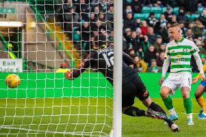 Leigh Griffiths makes it 3-1 for Celtic. Picture: SNS