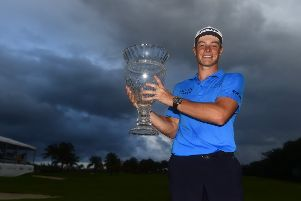 Viktor Hovland of Norway poses with the trophy on the 18th green after winning the Puerto Rico Open at Grand Reserve Country Club. Picture Jared C. Tilton/Getty Images