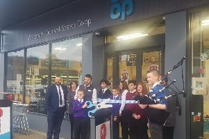 Cutting the ribbon at the new Co-op store on Stornoway's high street.