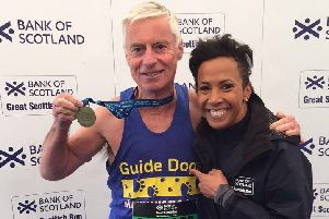 Charles with Dame Kelly Holmes after finishing the Great Scottish Run.