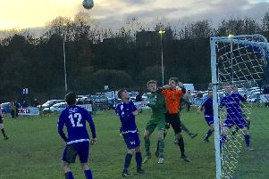 Goalkeeper Blair McIntosh punches clear to help the Hive claim a point against Montrose Roselea