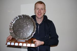 Lochs' John 'Uig' Morrison with the Player of the Year trophy.
