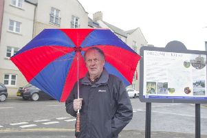 Kelso councillor Euan Robson shelters from pigeon mess at Henderson's Court.