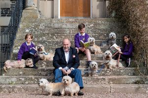 Borders Book Festival director Alistair Moffat and a trio of 11-year-olds from Melrose Primary School ' Ellie Darlow, Ben Cook and Maryan Khan ' launch this year's programme with a bevy of beautiful Dandie Dinmonts.