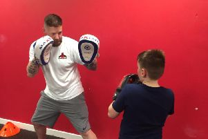 Darren sparring with young fighter