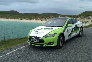 The TIG Tesla electric car pictured in Vatersay. The car is helping to highlight a campaign to provide climate change and energy saving advice to people across the Islands and those attending HebCelt 2019.