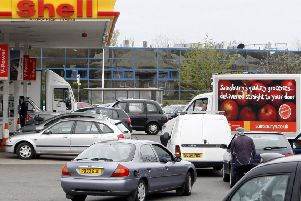 Cars queuing at a Shell garage.