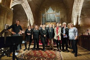 Midlothian Provost, Councillor Peter Smaill with the Junger Chor Hunshoven choir, from Midlothian's twinned district of Heinsberg, Germany, pictured at Crichton Collegiate Church.
