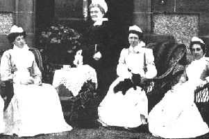 Miss Joss with some of her staff in 1889.