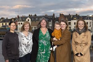 Stornoway's five-strong Community Council are Susanne Erbida, Melinda Gillen, Joan Muir, Jane Hepburn MacMillan (supported by her gorgeous daughter Florence) and Katie Laing.  Photo by Sandie Maciver of SandiePhotos