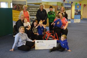 Pictured are Agnes Rennie and Lisa Maclean (UOG) presenting a cheque for �10,000 to the C�mhla group.