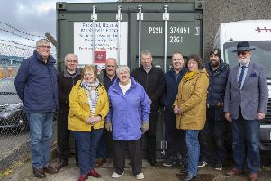 Representatives of Point and Sandwick Trust and the Parkend, Holm and Mackenzie Estate Residents Association with the new container. Picture by Sandie Maciver of SandiePhotos.