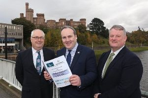 The Scottish Government's Minister for Energy, Connectivity and the Islands, Paul Wheelhouse MSP (centre) with Comhairle Chief Executive, Malcom Burr (left) and Chair of SDS, Frank Mitchell, at the signing of the new Charter Agreement.