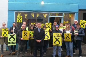 SNP candidate Angus Brendan MacNeil with his supporters outside of the campaign base in Stornoway.