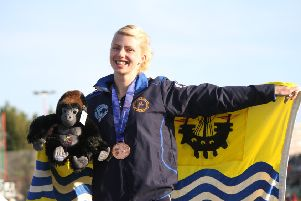Eve Carrington with one of her seven Island Games medals she won for WIIGA.