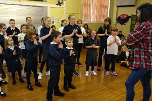 Shanta teaches pupils a Nepalese song and dance