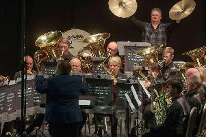 Percussionist Graham Borthwick crashes the cymbals to spectacular effect during Selkirk Silver Band's top-drawer display at Sunday's National Brass Band Championships of Great Britain in Cheltenham.  (Photo: British Bandsman Magazine).