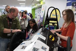 Pictured are college staff members Dave Black and Lauren Hamilton demonstrating the Greenpower electric racing car at the Diversity Celebration and Exhibition at Borders College.