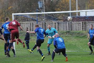Oakley, in red, put pressure on the Hawick goal in the first half (picture by Grant Kinghorn)