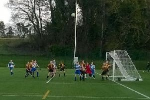 The young players (Melrose in black and yellow) keep their eyes on a high ball.