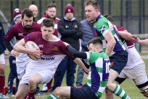 Gala YM try to create an opening against tough-tackling Dunbar, in green and blue (picture by Brian Gould).