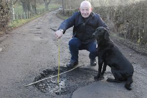 Elliot Henderson and his dog Hoover on the road up to Broomhill, Selkirk.