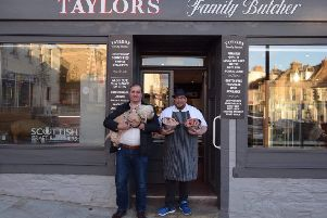 Calum Flanders, dog Lucy and John Taylor with the new sausages.