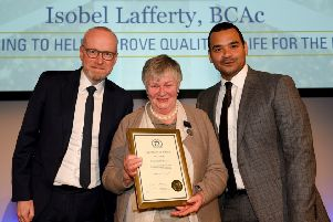 Isobel Lafferty with Chris Larmer from the Co-operative Bank, left, and awards host Michael  Underwood.