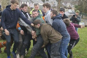 Robbie Elder, Craig Cowan and Craig Goodfellow grapple for the ba' at Ancrum.