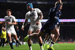 Ex-Hawick winger Darcy Graham celebrates scoring Scotland's fourth try agaisnt England at Twickenham (photo by Laurence Griffiths/Getty Images).