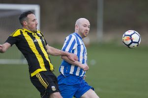 Stow, in black and yellow, were close to taking full points but Jed Legion dashed their hopes (picture by Bill McBurnie)
