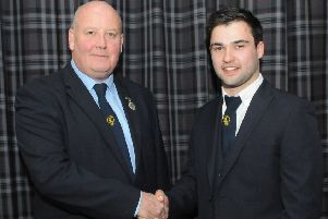 Hammermen deacon Alan Tough congratulates Aaron McColm on his appointment at Tuesday's AGM.