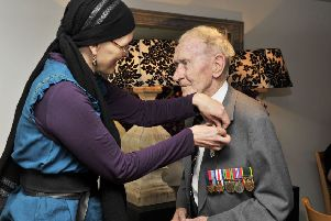 Jackie Webster said he was 'absolutely thrilled' to receive the Legion d'honneur from French vice-consul Emeline Javierre in 2016.