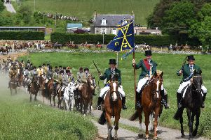 HAWICK, SCOTLAND - JUNE 08: Cornet Gareth Renwick and his equestrian supporters leaving St Leonard's during last year's Hawick Common Riding. Photo: Jeff J Mitchell/Getty Images