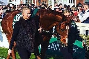 Connie Wishart (left) and Amy Coltherd lead Captain Redbeard around the Aintree parade ring (picture by Marion Pate).