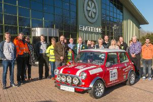 Pictured handing over the keys to the Mini Cooper to Borders Vintage Automobile Club vice-chairman Ken Grimes are the team from Emtelle at'their Haughhead manufacturing facility in Hawick.