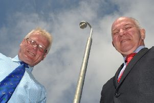 Councillors Stuart Marshall and Watson McAteer next to the surveillance camera watching over the town's Common Haugh car park.