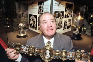 Walter McGowan, pictured holding a Lonsdale belt at an exhibition honouring him at Glasgows Kelvingrove art gallery in October 1992, was widely known for his speed around the ring and explosive punching power during a formidable boxing career
