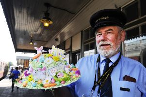 Station Master Bill Lord with the lost Easter bonnet
