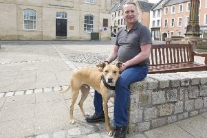 Mark Walker-Stewart and his dog 'Diesel' in Market Square, Jedburgh.