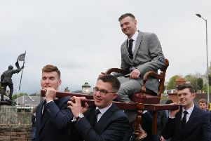 Craig Monks is carried on the traditional chair around the town before the Appointment Night Concert in the Victoria Halls.
