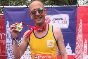 Borders MP John Lamont shortly after completing the 2019 London Marathon.