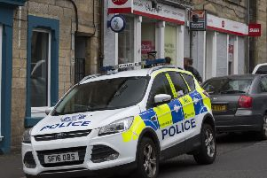 Police outside the Galapark Post Office in Galashiels after yesterday's robbery.