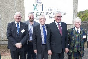 Hawick councillors, from left, Watson McAteer, Neil Richards, George Turnbull and Davie Paterson at Hawick's textile centre of excellence with, fourth from left, Fergus Ewing, Scotland's rural economy secretary.